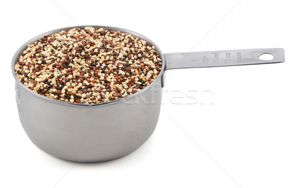 Mixed red, white and black quinoa in a cup measure Stock photo © sarahdoow