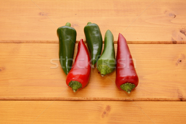 Five red and green hot chilis Stock photo © sarahdoow