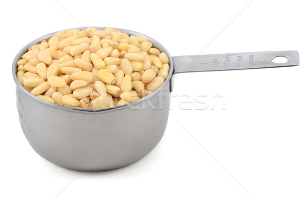 Pine nuts in a measuring cup Stock photo © sarahdoow