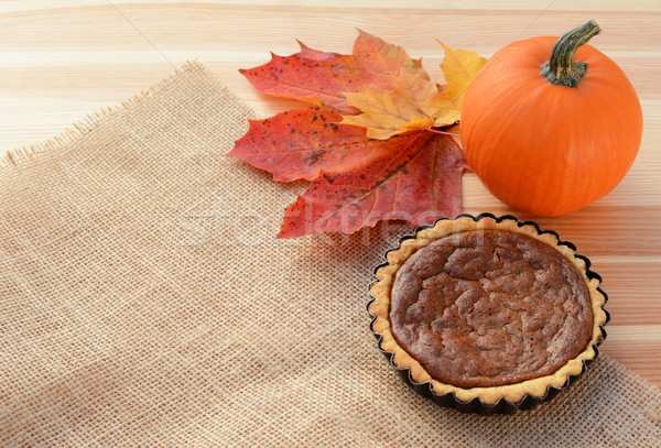 Small pumpkin pie with gourd and autumn leaves Stock photo © sarahdoow