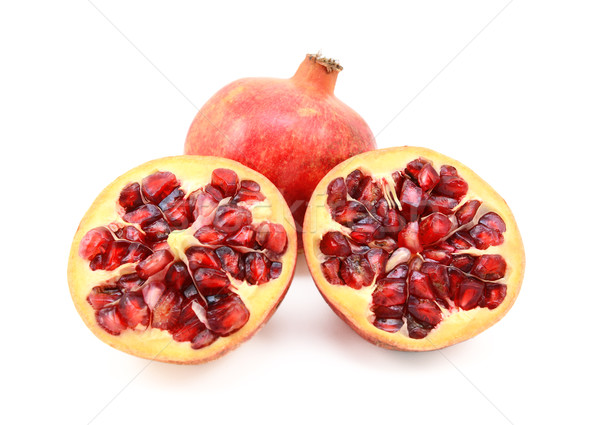 Whole red pomegranate and two cut halves showing seeds Stock photo © sarahdoow