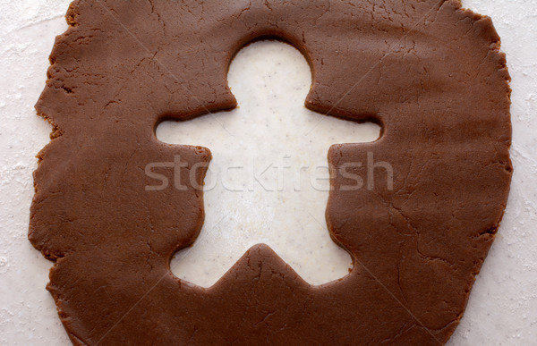 Cutout shape of a gingerbread man in cookie dough Stock photo © sarahdoow