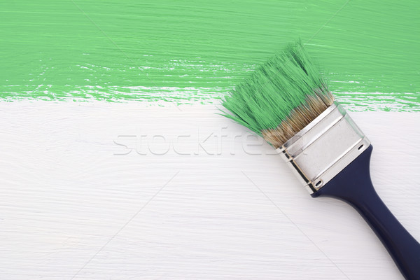 Stripe of green paint with a paintbrush on white Stock photo © sarahdoow