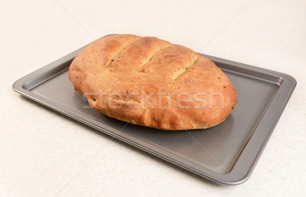 Freshly baked bread with slashed crust  Stock photo © sarahdoow
