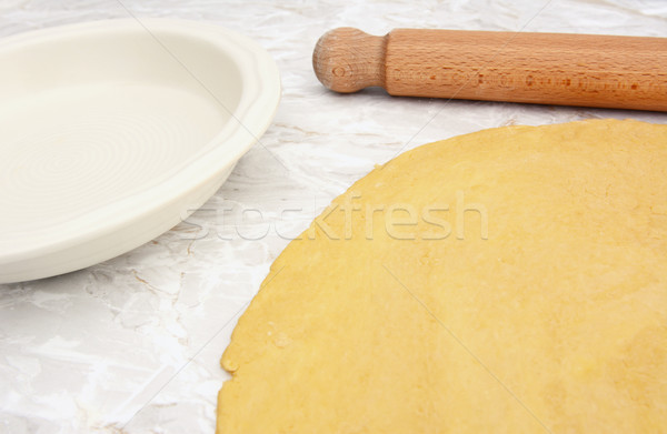 Pastry rolled out with rolling pin next to pie dish Stock photo © sarahdoow