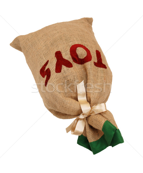Father Christmas's hessian toy sack tied with ribbon lying flat Stock photo © sarahdoow