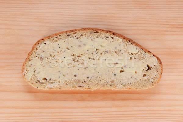 Slice of buttered bread on a wooden table Stock photo © sarahdoow