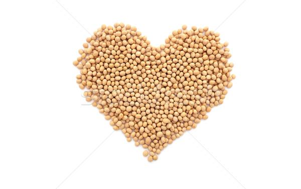 Soybeans, or soya beans, in a heart shape Stock photo © sarahdoow