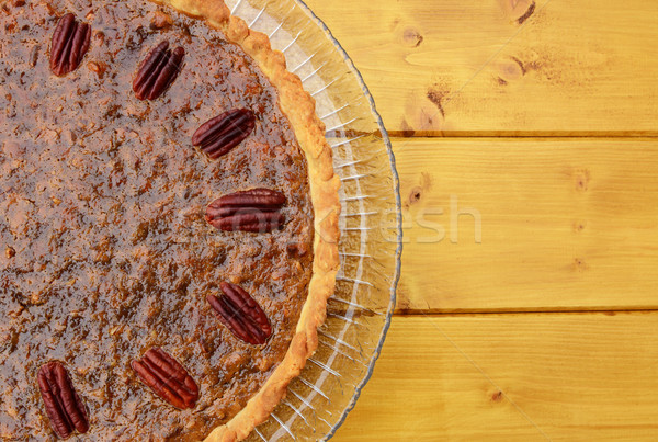 Half pecan pie served on a glass plate Stock photo © sarahdoow