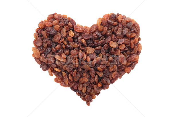 Sultanas in a heart shape Stock photo © sarahdoow