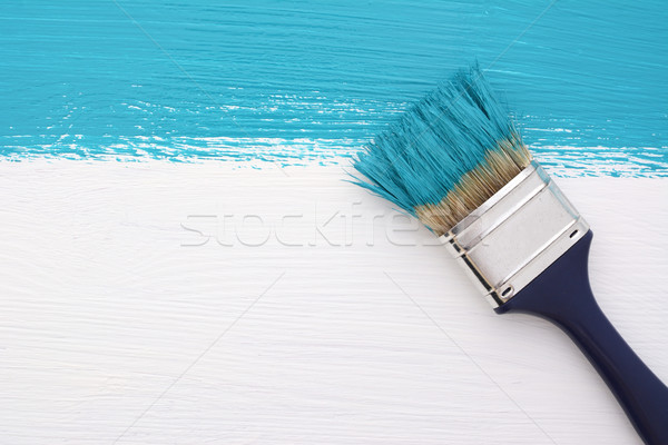 Stripe of turquoise paint with a paintbrush on white Stock photo © sarahdoow