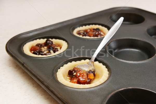 Spooning mincemeat into pastry cases  Stock photo © sarahdoow