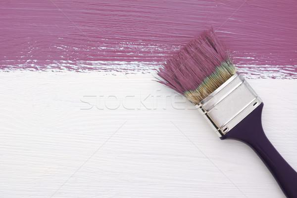 Stripe of plum paint with a paintbrush on white Stock photo © sarahdoow