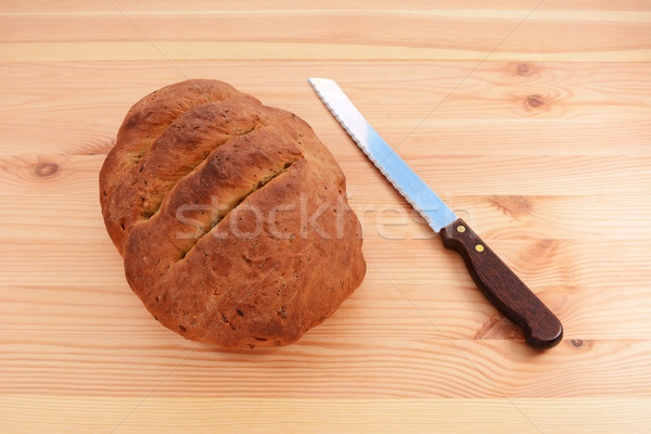 буханка хлеб ножом деревянный стол Сток-фото © sarahdoow