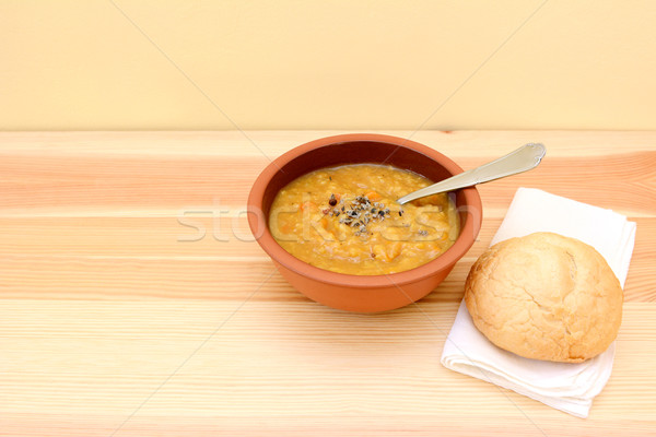 Vegetable soup served with seasoning and bread roll Stock photo © sarahdoow