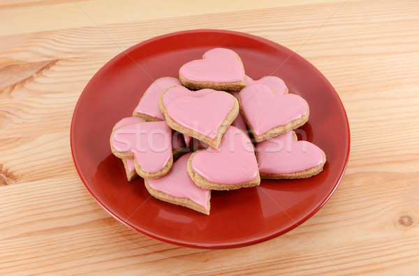 Red plate stacked high with iced heart-shaped cookies Stock photo © sarahdoow