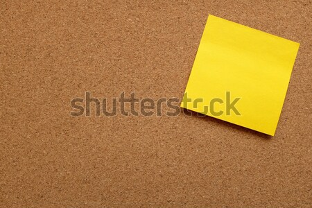 Yellow sticky note stuck on cork board Stock photo © sarahdoow