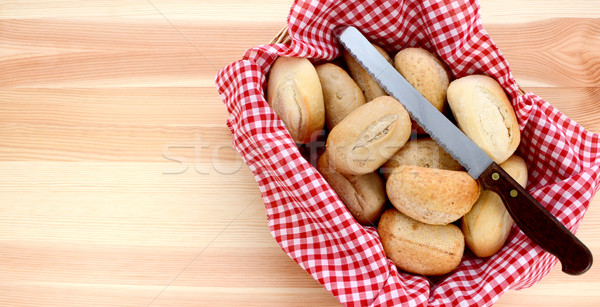Basket of petit pain and a bread knife  Stock photo © sarahdoow
