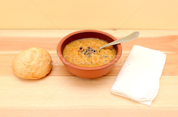 Lentil soup in a bowl with seasoning and bread roll Stock photo © sarahdoow