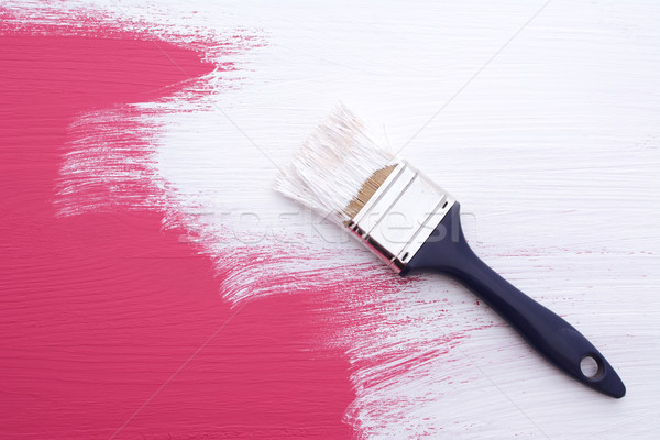 Covering pink paint with a coat of white emulsion Stock photo © sarahdoow