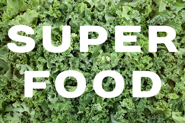 SUPERFOOD text over shredded kale leaves background Stock photo © sarahdoow