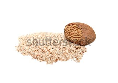 Grated nutmeg and whole nutmeg with grated face Stock photo © sarahdoow