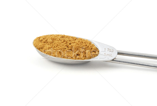 Ground cumin measured in a metal teaspoon Stock photo © sarahdoow
