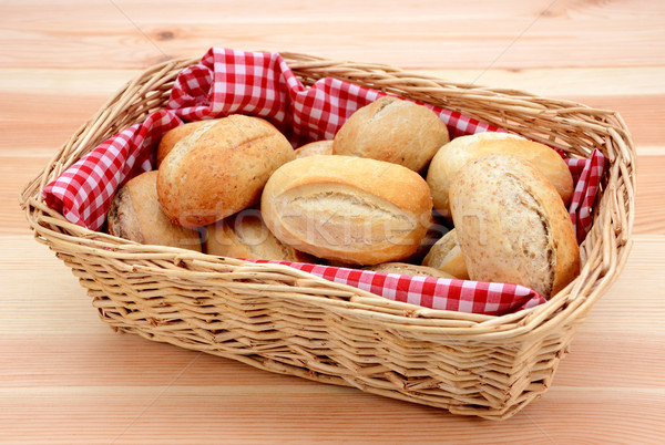 Basket full of fresh bread rolls Stock photo © sarahdoow