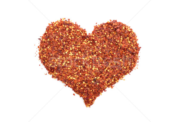 Hot and spicy crushed chillis in a heart shape Stock photo © sarahdoow