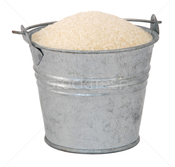 Golden granulated sugar in a miniature metal bucket Stock photo © sarahdoow