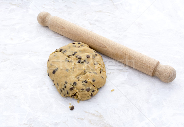 Ball of chocolate chip cookie dough with rolling pin Stock photo © sarahdoow