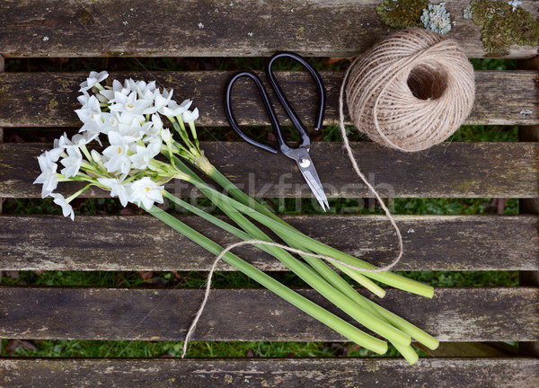 Ball of twine and scissors with bunch of white narcissi Stock photo © sarahdoow