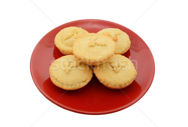 Stock photo: Five homemade mince pies on a festive red plate