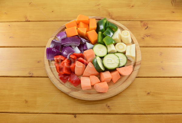 Selection of chopped vegetables on a wooden chopping board Stock photo © sarahdoow