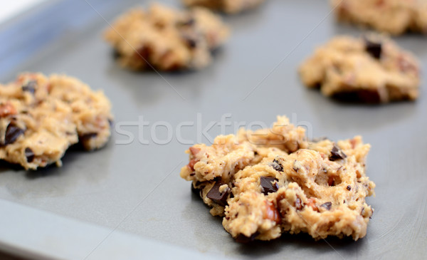 Spoonful of raw cookie dough ready for the oven Stock photo © sarahdoow