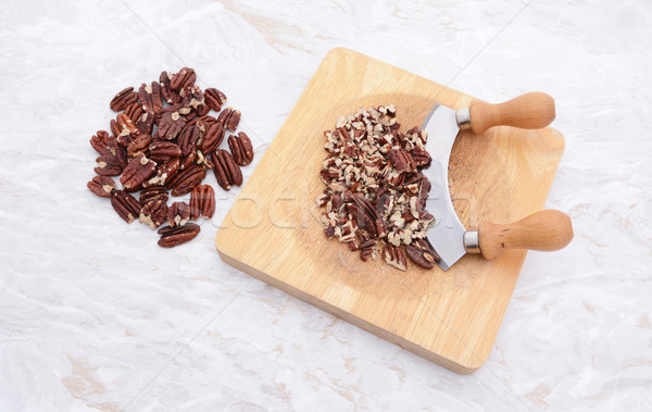 Toasted pecans with a rocking knife  Stock photo © sarahdoow