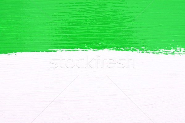 Stripe of green paint over white wooden background Stock photo © sarahdoow