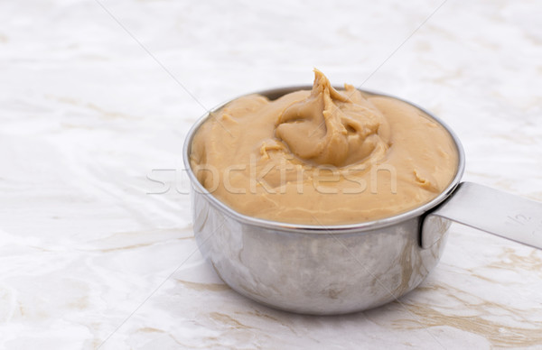 Peanut butter in a measuring cup Stock photo © sarahdoow