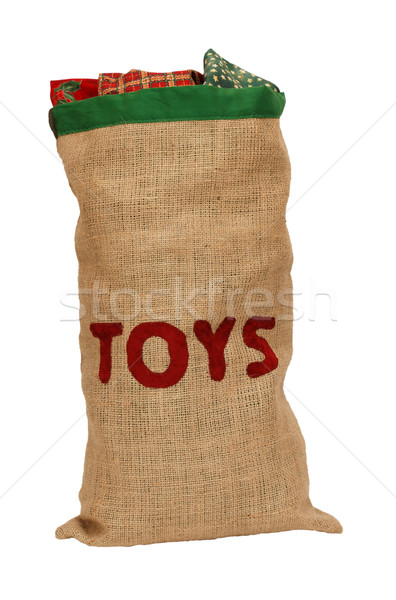 Hessian toy sack stuffed full with Christmas presents Stock photo © sarahdoow