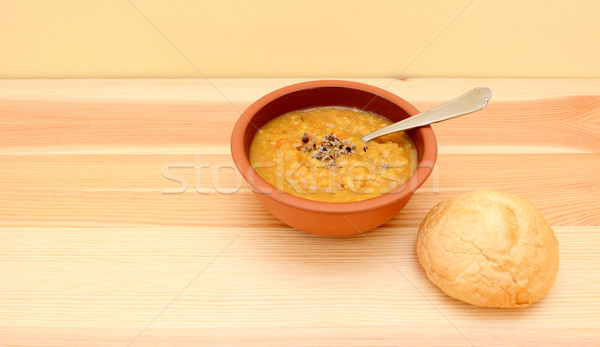 Stock photo: Seasoned lentil soup with a crusty bread roll