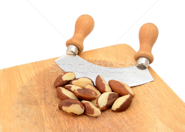Whole brazil nuts with a rocking knife Stock photo © sarahdoow