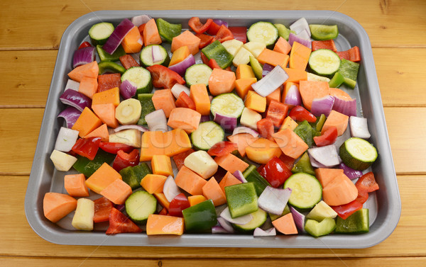 Chopped raw vegetables seasoned and drizzled with oil Stock photo © sarahdoow