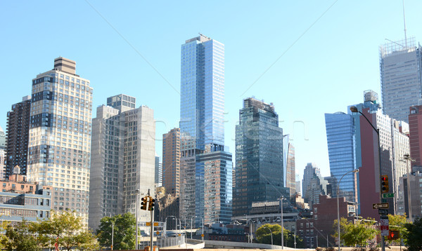 Skyscrapers and apartment buildings at intersection in New York  Stock photo © sarahdoow