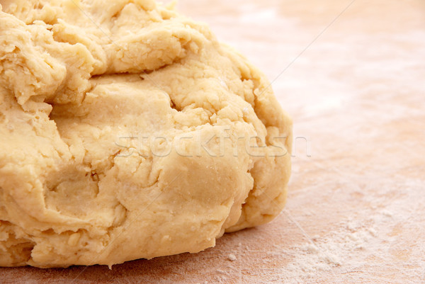 Fresh pastry on a floured wooden board Stock photo © sarahdoow