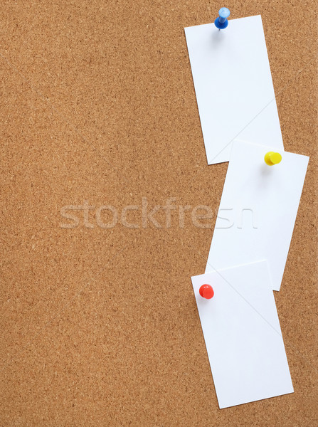 Cork noticeboard with three white cards pinned vertically Stock photo © sarahdoow