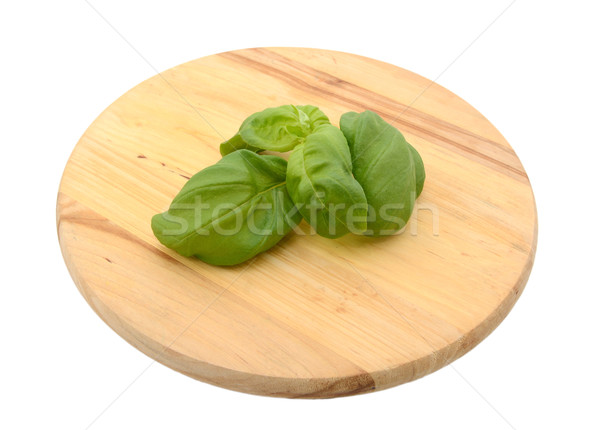 Sprig of fresh basil leaves on a chopping board Stock photo © sarahdoow
