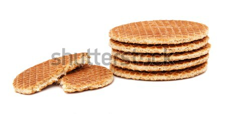 Stroopwafels, Dutch caramel waffles piled up, with one broken in Stock photo © sarahdoow
