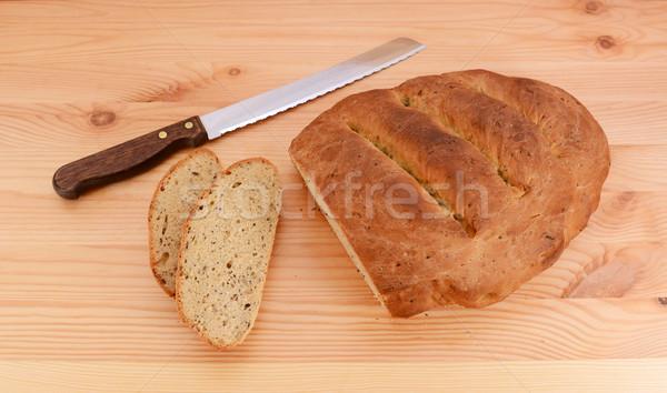 Plastry cięcia nasion bochenek ostry chleba Zdjęcia stock © sarahdoow