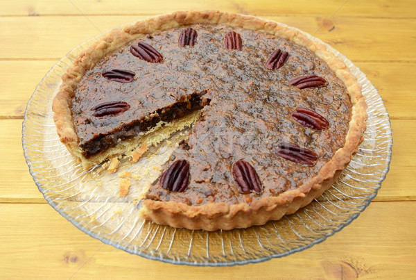 Pecan pie on a plate with one slice taken Stock photo © sarahdoow