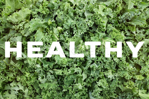 HEALTHY text over shredded kale leaves background Stock photo © sarahdoow
